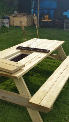 Picnic table with built-in coolers