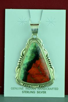 This beautiful sterling silver Sonoran Sunrise pendant is handcrafted by Will Denetdale, Navajo. The artist has selected a beautiful Sonoran Sunrise stone to create this piece of art. The Sonoran Sunrise stone is set in a smooth bezel surrounded by a rope design and hand stamp work. http://www.twodogssouthwestgallery.com/unique-jewelry/Sterling-Silver-Sonoran-Sunrise-Pendant-/