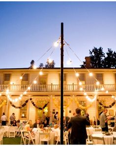 Majestic Maypole. A maypole-like structure hosted strings of lights and turned the area outside the historic Stagecoach Inn Museum into a reception-worthy space. Outdoor Party Lighting http://pinterest.com/wineinajug/outdoor-party-lighting/