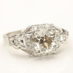 Another beautiful Old European Cut. I love the square feeling to the setting, as well as the overall art deco, vintage style to it. (Art Deco 90% Platinum Engagement Ring, with Old European Cut Diamond)
