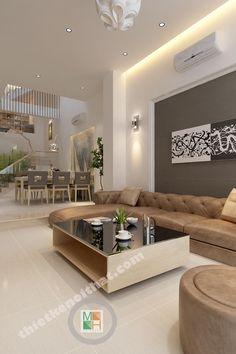 Thi công nội thất của nhà chị Hạnh với phong cách nhà phố hiện đại. Bước vào cửa bạn sẽ thấy phòng khách thông luôn với phòng ăn ở mé sau.