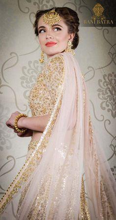 Understated & elegant – a muted peach base is elevated with rich gold and silver threadwork and embellishments, epitomizing regalia. For appointments call us on 9810352517. #BaniBatra #banibatradesigns #winterwedding #winterpastels #millenialpink #blushpink #dustyrose #indianfashion #weddinginspiration #instafashion #indianwear #weddingseason #banibatrabride #diwali #peach #mutedpeach #goldandsilver #threadwork #zari #peachprincess