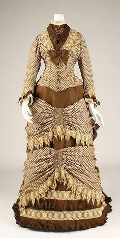 Dress, dots, lace, and bows.  Date: 1873–79 Culture: American Medium: silk  Metropolitan Museum of Art  Accession Number: 1989.246.7