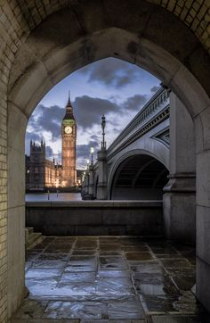 An early evening shot of Big Ben (the Elizabeth Tower, ahem), framed by a nearby archway just off of Westminster Bridge, London, UK