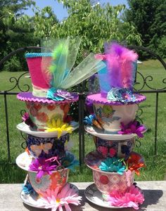 Looking for the perfect addition to your Alice in Wonderland themed shower? Planning a Mad Hatter tea party for your friends? This pair of Mad Hatter themed teacup centerpieces would be the perfect addition to display on the guest of honors table with your sweets and treats!  Each centerpiece has three gorgeous oversized teacups with mismatched plates/saucers. Each teacup & saucer is different from the next. They will be permanently glued together in a stack, slightly tilted, and decorated…