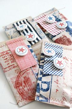 Gift Wrapping using recycled grocery bags, fabric, and button badges.