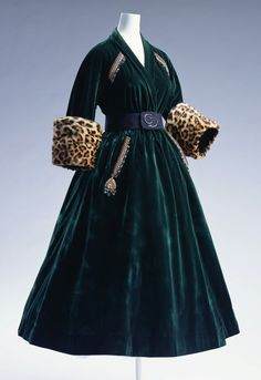 """Coat Dress, Christian Dior, Paris, France: autumn/winter 1947, velvet with leopard cuffs, trimmed with metallic embroidery, sequins and beading. """"...The New Look - Dior's nostalgic and elegant first collection featuring soft shoulders, a narrow waist and a full skirt - was the polar opposite of the austere clothing worn by women during the Second World War. The New Look, which heralded an era of peace, became an international success and went on to define fashion in the 50s..."""""""
