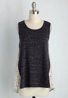 If what to wear to a tea shop date has you in a tizzy, this mixed media tank top will put you at ease! Infusing a heather black front with a pleated chiffon back, this dotted top is steeping with sweet style that satisfies that haute craving while you sip.
