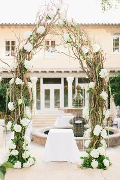 Wedding arch. Amazing flowers and branches.