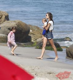 Alessandra Ambrosio with her children Anja and Noah at the Beach in Los Angeles, CA - July 4, 2013