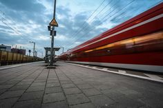#blue sky #blur #commuting #industrail #motion #platform #red #train #train station #transport