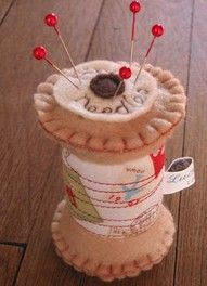 Embroidered felt spool of thread pin cushion.  Could there be anything more wonderful?