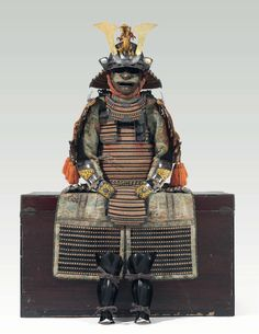 A red-laced armor with two-piece cuirass (Aka-odoshi Nimai-do gusoku) together with saddle and accessories. Edo period (18th century). The distinctive silver roundels with crossed hawk's feathers are the badges (mon) of the ancient Abe clan and their branches, became prominent in Japan during the Edo period. -Christie's-