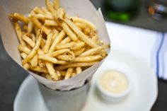 No burger or sandwich is complete with a side of the best French fries. NYC restaurants have some of the best pomme frites from thrice-cooked fries to poutine.