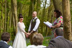 The very first wedding ceremony conducted by a wedding celebrant in the bluebell woods at Jimmy's farm, Suffolk. www.headoverheelsphotography.co.uk
