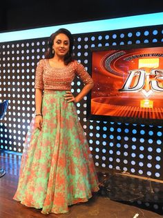 Pearle Maaney in pink coloured stone worked crop top and floral skirt. costume by paislee