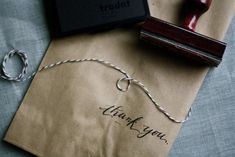 "calligraphy ""thank you"" paper bags"