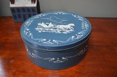 $11.90 ✿ bluefolkhome on etsy ✿ Round Cookie Tin Horse Drawn Buggy Slate Blue Round Tin Box 1970  Blue and Creme Round Tin 10 inch Diameter I Ship Worldwide