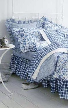 The charm of blue and white gingham mixed with blue and white florals and solids makes this bedding so dreamy!