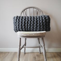 Stylish and understated this dark grey chunky knit cushion brings subtle Scandinavian texture and aesthetic.  I hand knit each cushion in my studio in devon from start to finish on chunky needles using beautiful merino wool. Its relaxed style and chunky knit are perfect for Scandinavian minimalism adding plenty of texture and tactility. The granite grey colour works well in a monochrome room as well as contrasting beautifully with dusty colours and brights such as mustards or blues.  This…
