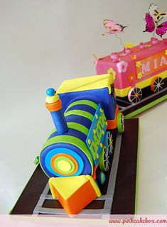 Dual Birthday Train Cake by Pink Cake Box in Denville, NJ.  More photos and videos at http://blog.pinkcakebox.com/dual-birthday-train-cake-2010-09-26.htm