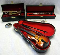"""Miniature Musical Instruments with Cases Violin - measures 6.5"""" Clarinet - measures 6"""" Trumpet - measures 4.5"""" All in excellent condition."""