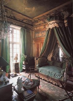 Jacques Garcia's Paris home. Green French Neoclassical Aubusson rug and door panels, Neoclassical canopy bed, chandelier.