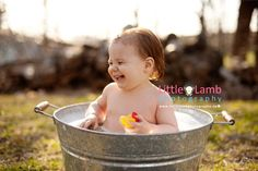 Ottawa photographers.  Large metal tub and bubble bath for baby photo shoot.  Photography by Little Lamb Photography.