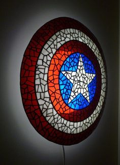 Superhero Novelty Captain America Shield Lamp - Lamps are quite common in bedrooms but if you want your son's superhero bedroom to stand out then try purchasing some unique designs for his lamps. This is an example of a unique lamp design, Steve Rogers A.K.A Captain America's shield.