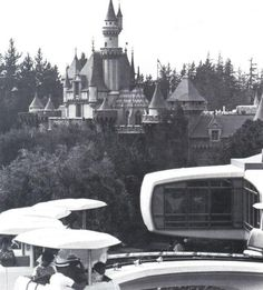 Disneyland; Sleeping Beauty Castle; Home of the Future... with the Peoplemover in the foreground.