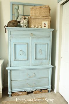 Refurbished, Sea-Inspired Armoire. Note the 2 baskets on the floor!!!!!!
