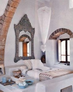 Idk how I feel about mirrors above a bed or directly across from a bed (superstitious) but I would love to incorporate a Morrocan theme like this.