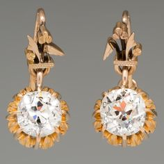 These stunning Victorian drop earrings feature beautiful old mine cut diamonds in hand-engraved yellow gold. The diamonds are beautifully cut and have an amazing sparkle. One diamond weighs carats and the other weighs carats. Ruby Jewelry, Fine Jewelry, Jewlery, Diamond Drop Earrings, Stud Earrings, Victorian Gold, July Birthstone, Hand Engraving, Vintage Earrings