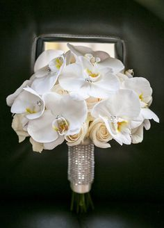 2. Think outside the flower. Get playful with crystals, feathers- the options are endless, as long as it's a look you love! Wedding Bouquets, Bridal Bouquets, Bouquet Wraps