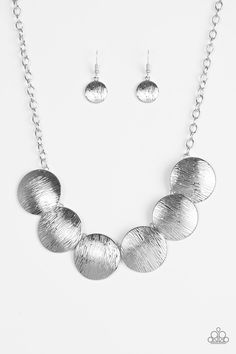 Glued To The SPOTLIGHT - Silver Necklace - $5 * Embossed in shimmery linear patterns, round silver frames link below the collar for a bold industrial look. Features an adjustable clasp closure. * Sold as one individual necklace. Includes one pair of matching earrings.