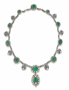 A late 19th century cabochon emerald and diamond necklace  Designed as a graduating series of cabochon emerald and old brilliant-cut diamond clusters, connected by old brilliant-cut diamond anthemion motifs, suspending a sugarloaf emerald and old brilliant-cut diamond oval pendant, composite, mounted in silver and gold, diamonds approximately 19.50 carats total, length 53.0cm
