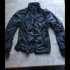 Lululemon size 8 Perfect Condition charcoal ruched Lululemon size 8 Perfect Condition charcoal ruched jacket. Zip pockets, hand warmer sleeves and thumb holes. Small ruffle design w breathable mesh. Full zip up front. lululemon athletica Jackets & Coats