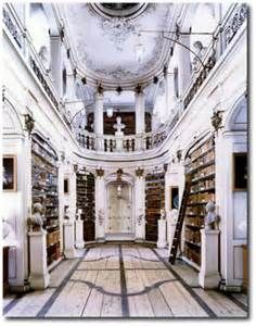 The Beautiful German Library: The Anna Amalia Library is a great depiction of the Rococo Style. It features parquet wood plank floors with black accent borders contrasting with the curvy upper gallery, simple set back book cases and soft white and blue painted walls. The narrow curvy floor plan is very dramatic.