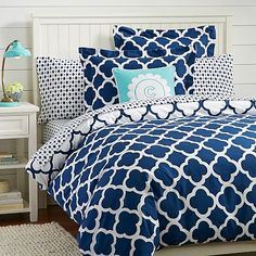 Navy and Orange Bedroom Idea - Lucky Clover Reversible Duvet Cover + Sham, Royal Navy from Pottery Barn Teen