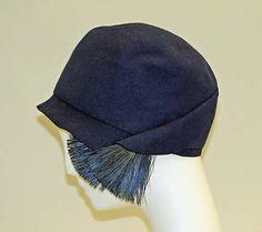 "Cloche, Bonwit Teller & Co. (American, founded 1907): ca. 1925-1930, American, wool, feathers. Marking: [label] ""Bonwit Teller & Co., N.Y."""