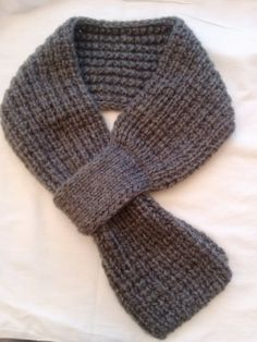 This fashionable gray scarf is perfect for warming up during the holidays.  Or even as a gift for a loved one.     To wear it you simply slip one