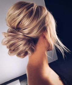 Beautiful voluminous low, chignon-style bun-- perfect updo for any special occasion or wedding.
