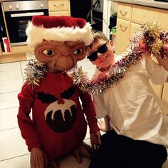 E.T. dressed for Christmas with his friend