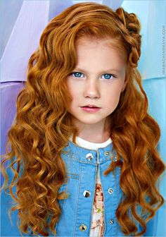 Ginger girl with bright blue eyes                                                                                                                                                     More