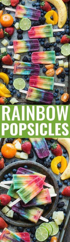 Outstanding 7 layer rainbow popsicles! Make your own homemade rainbow popsicles with lots of fresh fruit! *Sub vegan yogurt for Greek yogurt if you like.*
