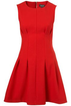 Great little red dress! This could be dressed up or down. Silhouette good for all body shapes, too.