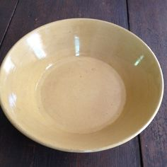 """YELLOW WARE BOWL  130.00 Butternut yellow, beautiful patina,elegance, charm and down home country solidity, the complimentsthe couplereceives on this rare Yellow Ware Bowlwill reflect back on you! It looks lovely with our Carving Set. 10.25""""D 3"""" H"""