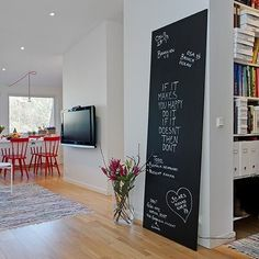 A Blackboard Wall For Commitmentphobes - paint a large piece of plywood with blackboard paint (yes, blackboard paint is a huge trend)
