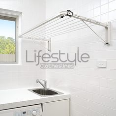 Austral Indoor Outdoor Clothesline Mounted in Laundry Room