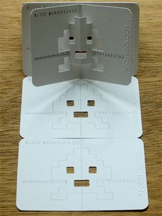 Pop Up Business Card  Creative business cards inspired by pop-up books and Space Invaders.